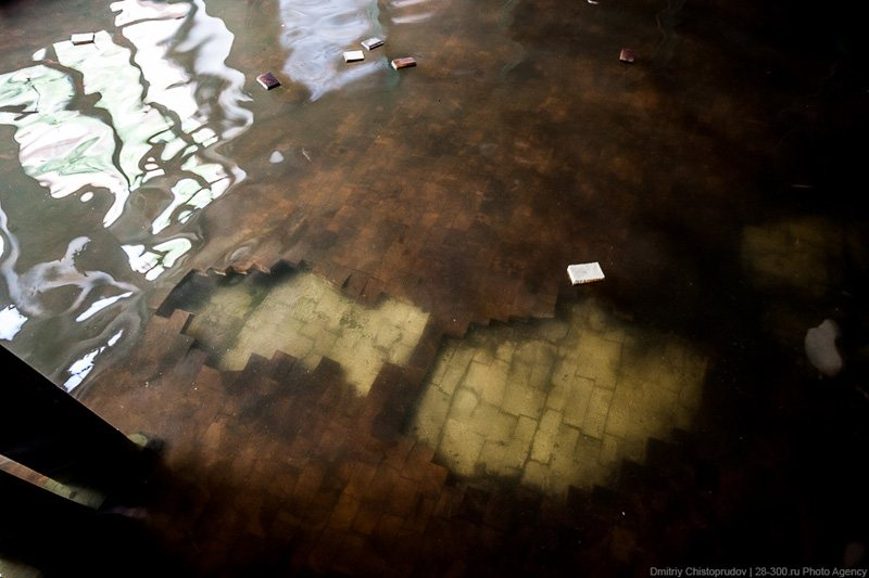 Pieces of parquet in the flooded restaurant