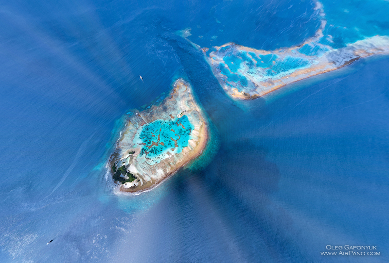 Southern Maldives. Over the coral reef