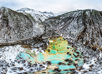 Multi-Colored Pond among mountains
