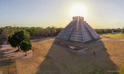 Mexico, Chichen Itza. Sun behind of the Temple of Kukulcan