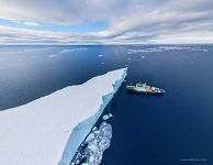 Iceberg and Polar Pioneer expedition ship. Antarctica