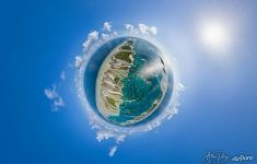Above islets and reefs. Planet