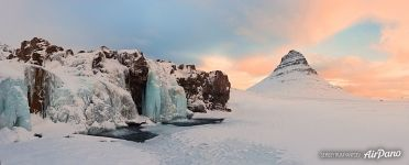 Mount Kirkjufell and frozen waterfall