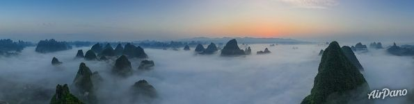 Panorama above clouds and mountains