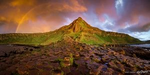 Rainbow above the Giant's Causeway. Panorama